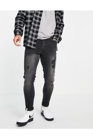 New Look Skinny jeans with rips in washed black