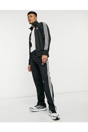 adidas Adicolor Firebird three stripe joggers in black
