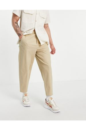 ASOS Oversized tapered chinos in -Neutral