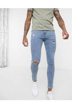 ASOS Spray on jeans in power stretch denim in light wash blue with abrasions