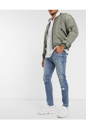ASOS Skinny jeans in tinted light wash blue with rips