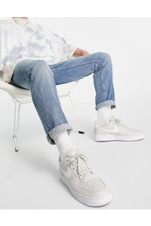 New Look Slim jeans with chain in mid wash blue