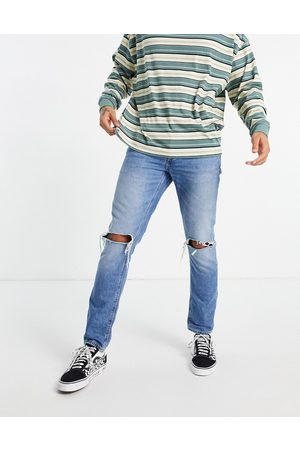 ASOS Slim jeans in vintage mid wash blue with knee rips