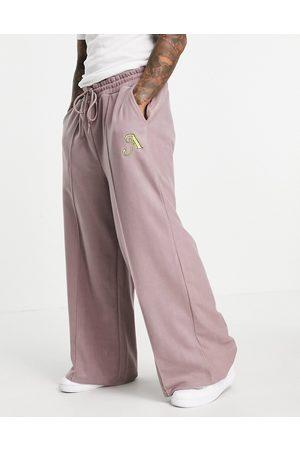 ASOS Herre Joggebukser - Polar fleece wide leg joggers with applique in purple