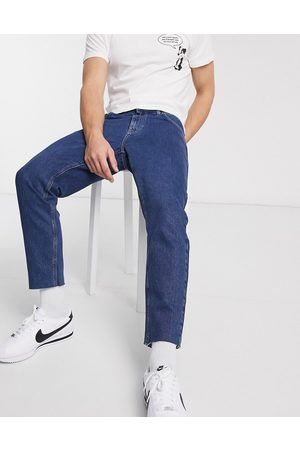 ASOS Classic rigid jeans in mid wash blue with raw hem