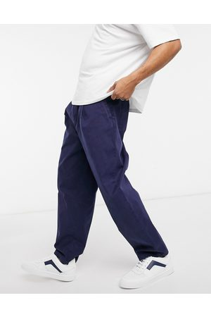 ASOS Wide leg trousers with pleats in washed navy