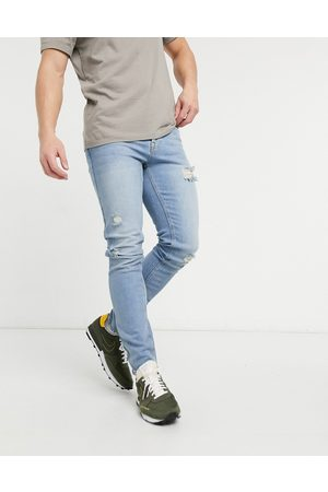 ASOS Skinny jeans in vintage light wash with rips-Blue