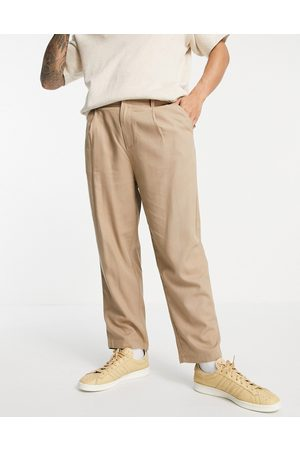 ASOS Wide leg trousers with pleats in linen mix-Neutral