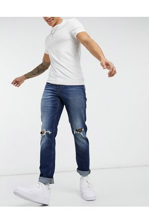 ASOS Stretch slim jeans in dark wash blue with knee rips