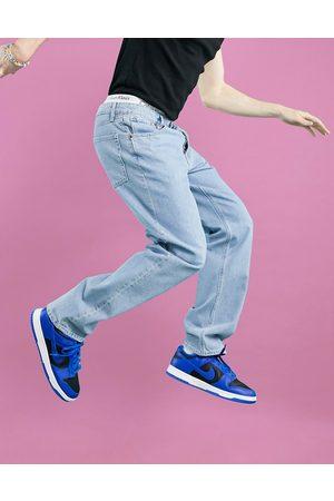 ASOS Straight leg jeans in light stone wash-Blue