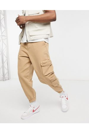 ASOS Oversized tapered joggers in heavy washed canvas-Neutral