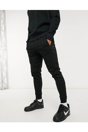 Nicce London Mercury joggers in black