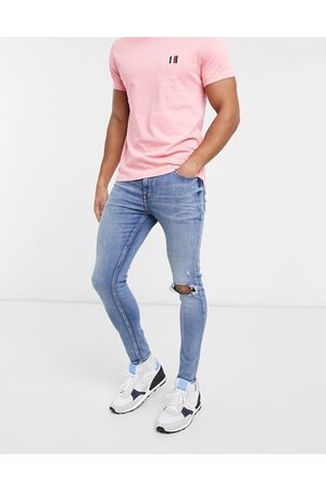 ASOS Spray on jeans with power stretch in mid wash blue with knee rips