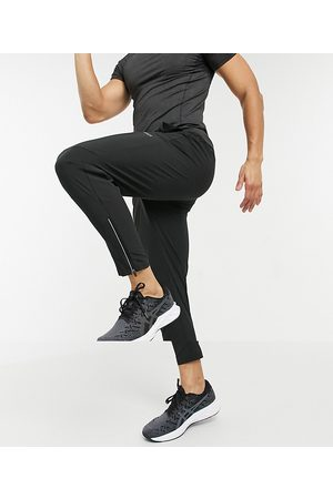 ASOS Woven skinny tapered running joggers with reflective zip detail-Black