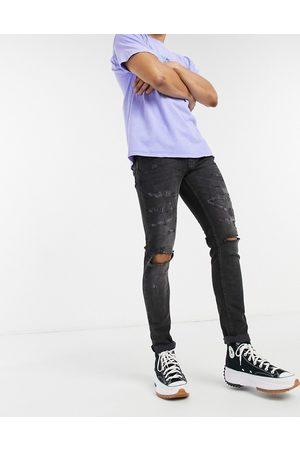 Topman Organic cotton blend stretch skinny jeans with rips in washed black