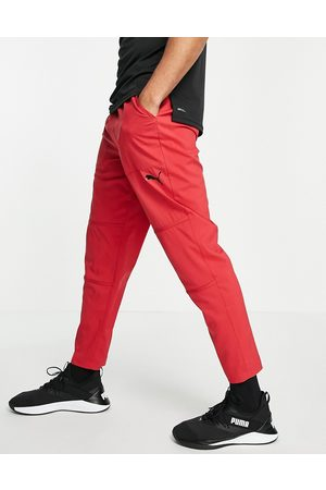 PUMA Training trousers in red with vents