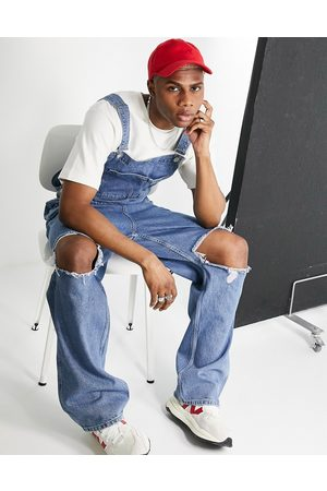 ASOS Baggy denim dungarees in mid wash with knee rips-Blue