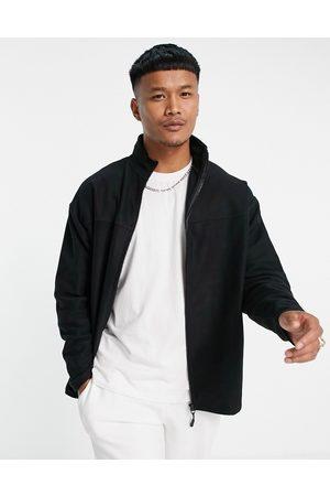 ASOS Oversized polar fleece track jacket in black