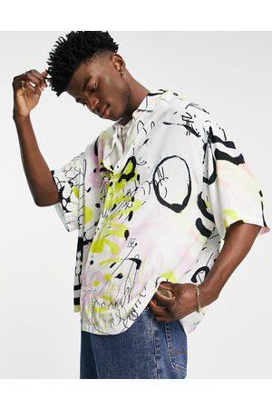 ASOS Boxy oversized grafitti print shirt in white