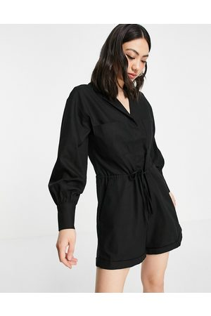 Pretty Lavish Dame Playsuits - Utility playsuit with pockets in black-Neutral