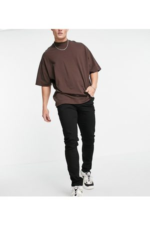 COLLUSION X001 skinny jeans in black