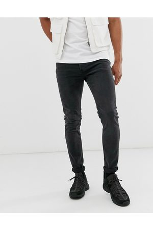Topman Stretch skinny jeans in washed black