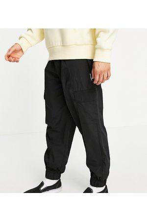 COLLUSION Dame Cargobukser - Nylon cargo trousers with pockets in black