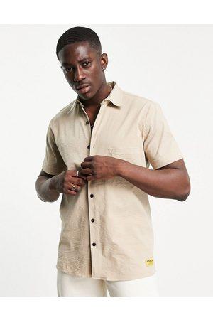 Cat Footwear Caterpillar short sleeve logo pocket shirt in camel-Neutral