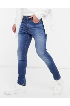 Tommy Hilfiger Austin slim tapered jeans in mid wash-Blue