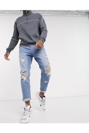ASOS Tapered carrot jeans in vintage light wash with heavy rips-Blue
