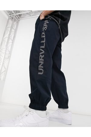 ASOS Unrvlld Spply Oversized tapered joggers in blue-Navy