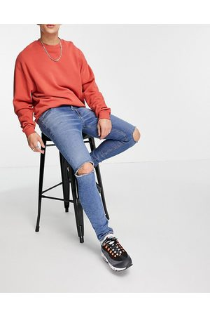 ASOS Skinny jeans with 'less thirsty' wash in mid blue with knee rips
