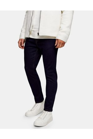 Topman Herre Tapered - Stretch tapered jeans in raw denim-Blue