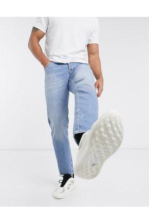 ASOS Stretch tapered jeans in vintage light wash blue