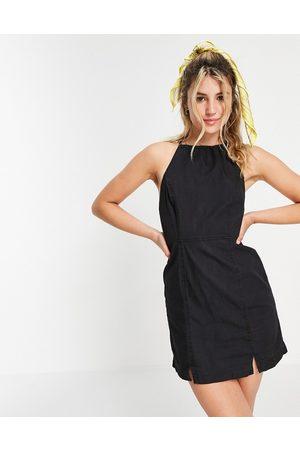 ASOS Dame Bodycon kjoler - Soft denim halterneck slip dress in black