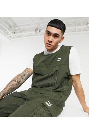 PUMA Avenir chest pocket vest in khaki exclusive to ASOS-Green