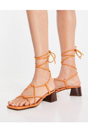 ASOS Holden premium leather tie leg heeled sandals in apricot-Orange