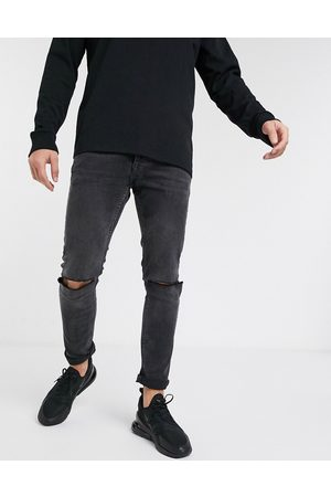 Topman Stretch skinny jeans with knee rips in washed black