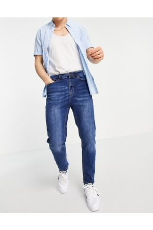 New Look Herre Tapered - Tapered jeans in mid blue wash
