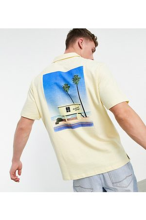 Reclaimed Inspired jersey shirt with holiday graphic-Yellow