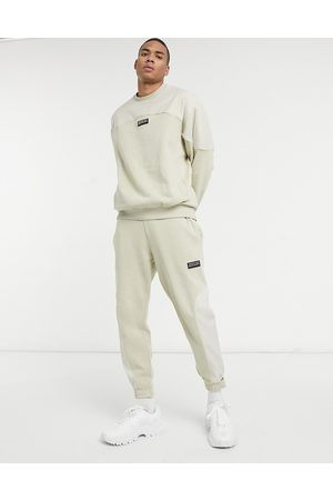 ASOS Unrvlld Spply Co-ord tapered joggers in with nylon colour block panels-Neutral