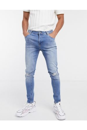 ASOS Herre Skinny - Spray on jeans with power stretch in mid wash blue with rips