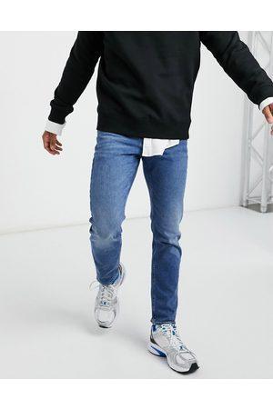 ASOS Stretch slim jeans in vintage mid wash blue