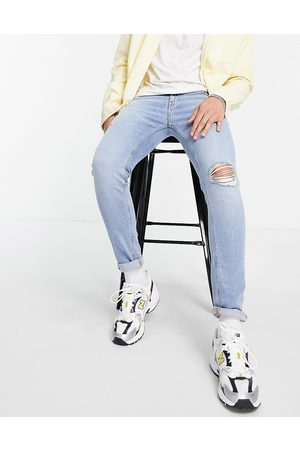 ASOS Skinny jeans with 'less thirsty' wash in light blue with rips