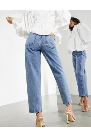 ASOS Dame Tapered - Tapered jean with twisted seam in mid wash-Blue