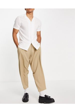 ASOS Oversized tapered smart trouser with double pleat in stone-Neutral