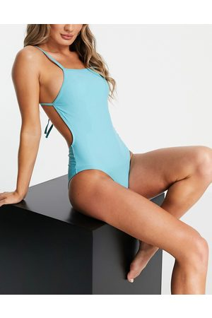 Pieces Open back strappy swimsuit in turquoise-Blue