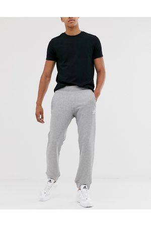 adidas Essentials logo joggers in grey