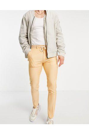 ASOS Super skinny suit trousers cotton linen pinstripe in orange