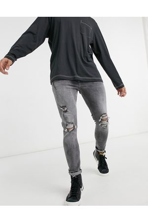 Bershka Super skinny fit jeans with rips in grey